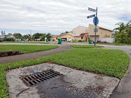 This photo shows a catch basin for water in Sweetwater, Fla. The Miami suburb was flooded in 1999 by a hurricane and again in 2000 by more storms - they received $2 million from FEMA for debris removal and repairs to public facilities, including this and other drains, according to Mayor Orlando Lopez. More than a decade later, FEMA demanded the money back, citing a lack of documentation for the costs.