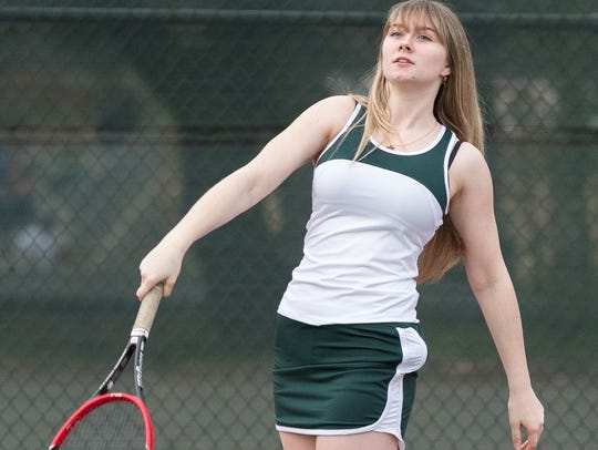 Shasta College freshman Abby Davis follows through