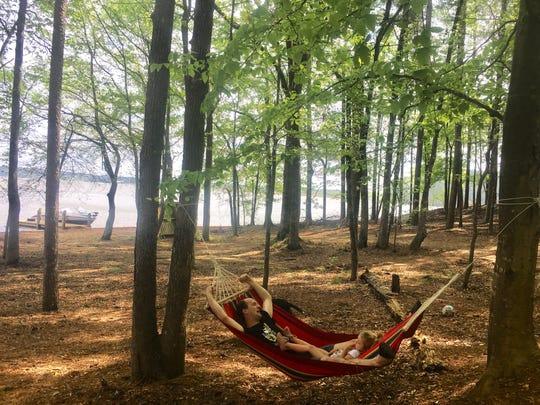 Eric Guidry rocks in a hammock with daughter Avery, 3.