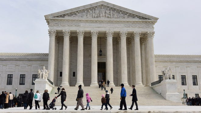 Visitors stand in line Feb. 19, 2016, to enter the U.S. Supreme Court in Washington.