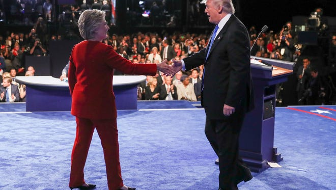 Democratic presidential nominee Hillary Clinton shakes hands with Republican presidential nominee Donald Trump after the presidential debate at Hofstra University in Hempstead, N.Y., Monday.