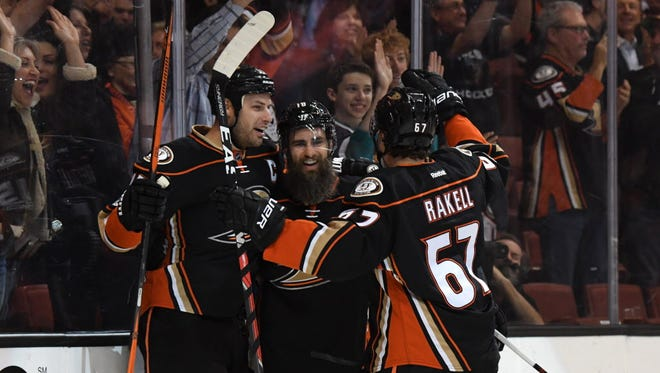 Anaheim Ducks right wing Patrick Eaves (18), center, celebrates with teammates Ryan Getzlaf (15) and Rickard Rakell (67) after scoring a goal in the first period against the Edmonton Oilers.
