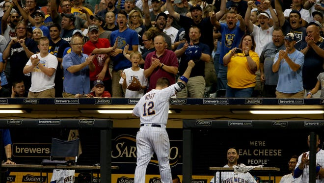 Stephen Vogt takes a curtain call after his two-run homer in the seventh inning against the Marlins on Friday night at Miller Park.
