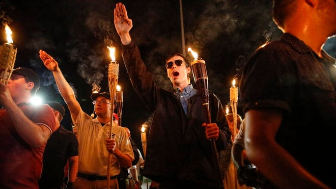 White nationalists with torches march through Charlottesville, Va., Aug. 11, 2017.