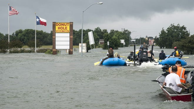 Rescuers and volunteers help to evacuate the Gulf Health Care Center, a nursing home in Port Arthur, Texas, on Aug. 30, 2017.