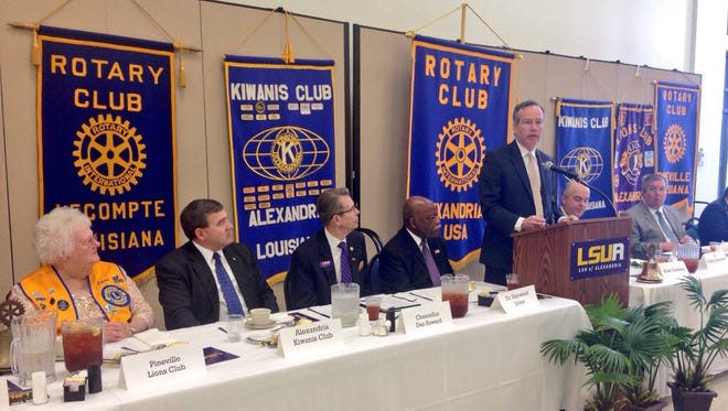 """LSU System President and Chancellor F. King Alexander addresses community leaders about """"the real cost of budget cuts"""" at Louisiana State University of Alexandria's annual civic luncheon Tuesday. Representatives of area Rotary, Kiwanis and Lions Clubs attended."""
