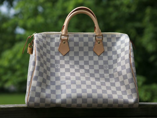 Some of Cheri Brown's favorite things are her Louis Vuitton handbags.