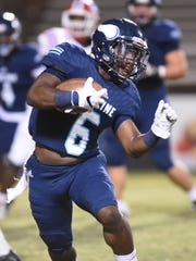 Airline's Jaylyn Thomas runs with the ball during the