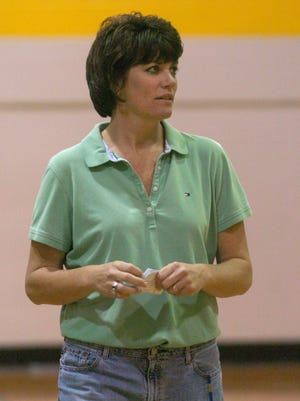 Christie McDonald, seen coaching Newport Central Catholic in 2006, is in her 25th straight season of coaching.