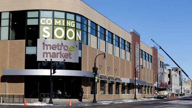 The Shorewood Metro Market building is being sold, and the new owner doesn't need a village loan to help finance its parking structure.