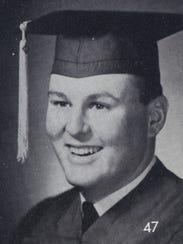 A file photo of a young Geno Martini wearing a graduation