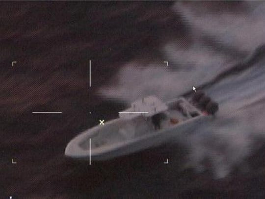 A U.S. Coast Guard photo shows a stolen boat trying to outrun Coast Guard units on Christmas Eve in the Gulf of Mexico