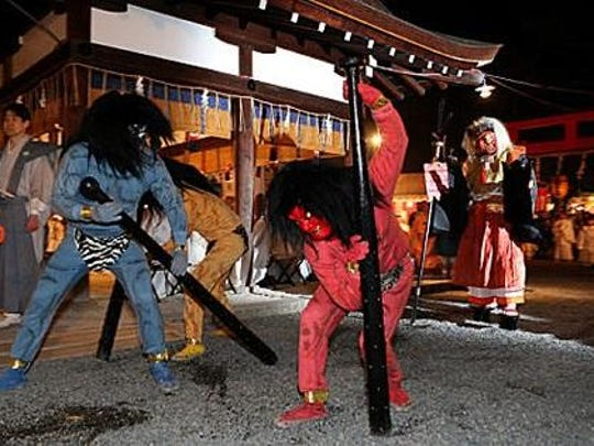 Participants in the Japanese traditional New Year's event called setsubun.