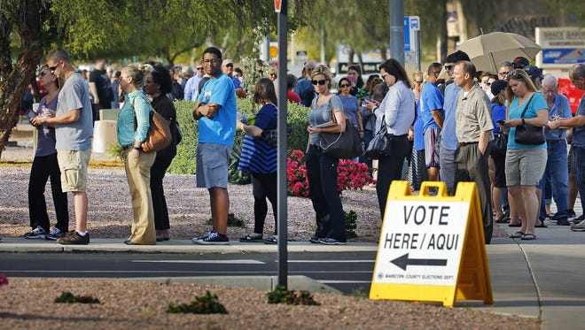 People wait in line to vote in the Arizona Presidential Primary Election at Mountain View Lutheran Church Tuesday, March 22,  2016  in Phoenix, Ariz.