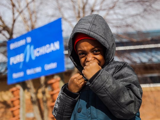 Isiah Brooks, 4, poses for a picture shortly after arriving in Michigan. Brooks was the youngest of the Wilmington group to make the trip to Flint.