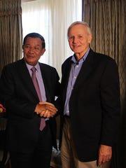 "Cambodia Prime Minister Hun Sen, left, with  ""Angkor Awakens"" director Robert Lieberman."