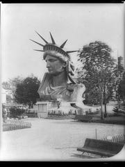 The completed head of the Statue of Liberty was displayed at the Paris World's Fair in 1878. Proceeds from postcard and souvenir sales helped fund the full statue's construction.