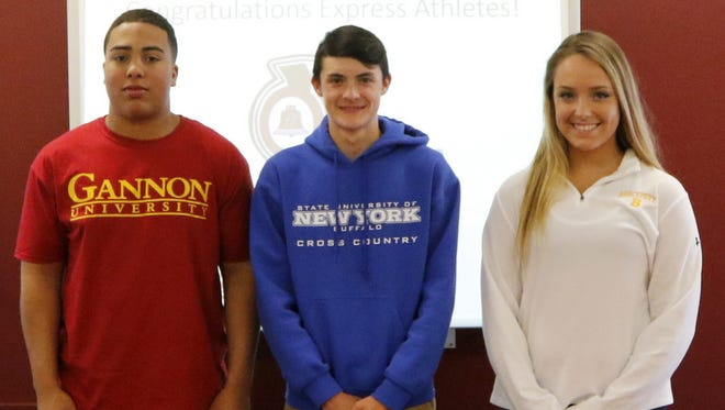 Elmira High School seniors, from left, DaShaun Sutton, Ben Cardamone III and Loren Sayers on Wednesday afternoon at a signing ceremony at the school's community room.