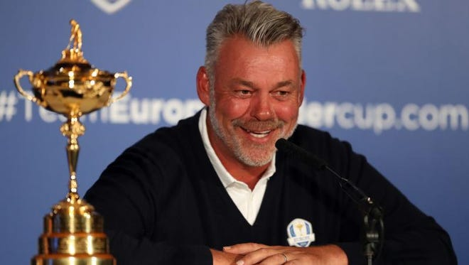 European Ryder Cup captain Darren Clarke smiles during a press conference at Wentworth Golf Club in Virginia Waters, England Tuesday. Lee Westwood, Martin Kaymer and Thomas Pieters will fill out the European team as Darren Clarke's captain's picks for the Ryder Cup against the United States at Hazeltine from Sept. 30-Oct. 2.