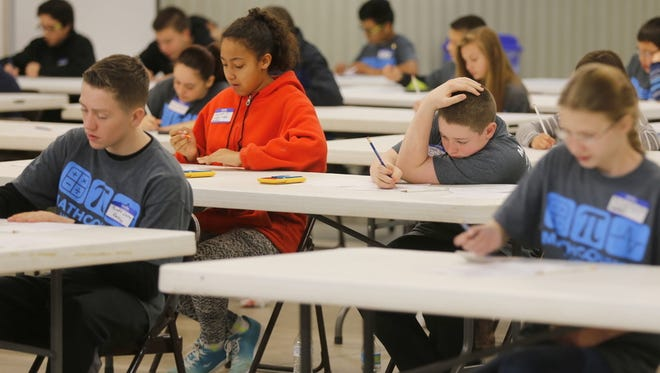 Students compete in the Target Round during the MATHCOUNTS math competition at McGee Park on Saturday.