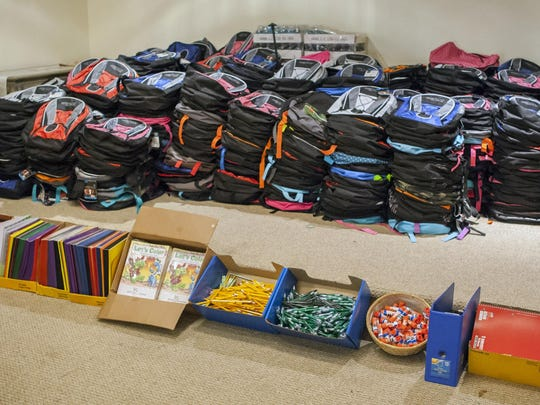 Piles of new school supplies wait for students at the Faith Victory Christian Center in Claymont on Wednesday afternoon.
