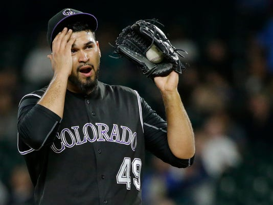 Colorado Rockies starting pitcher Antonio Senzatela wipes his brow on the mound after being called for a balk, which sent Seattle Mariners' Jarrod Dyson to second base during the fifth inning of a baseball game, Wednesday, May 31, 2017, in Seattle. (AP Photo/Ted S. Warren)