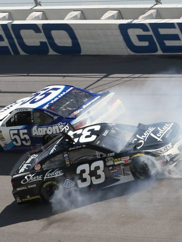 Brian Scott (33) and Michael Waltrip (55) spin into