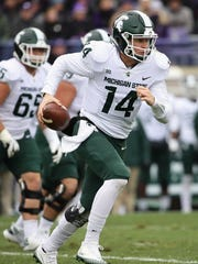 MSU's Brian Lewerke runs for a first down against  Northwestern at Ryan Field on Saturday, Oct. 28, 2017 in Evanston, Ill.