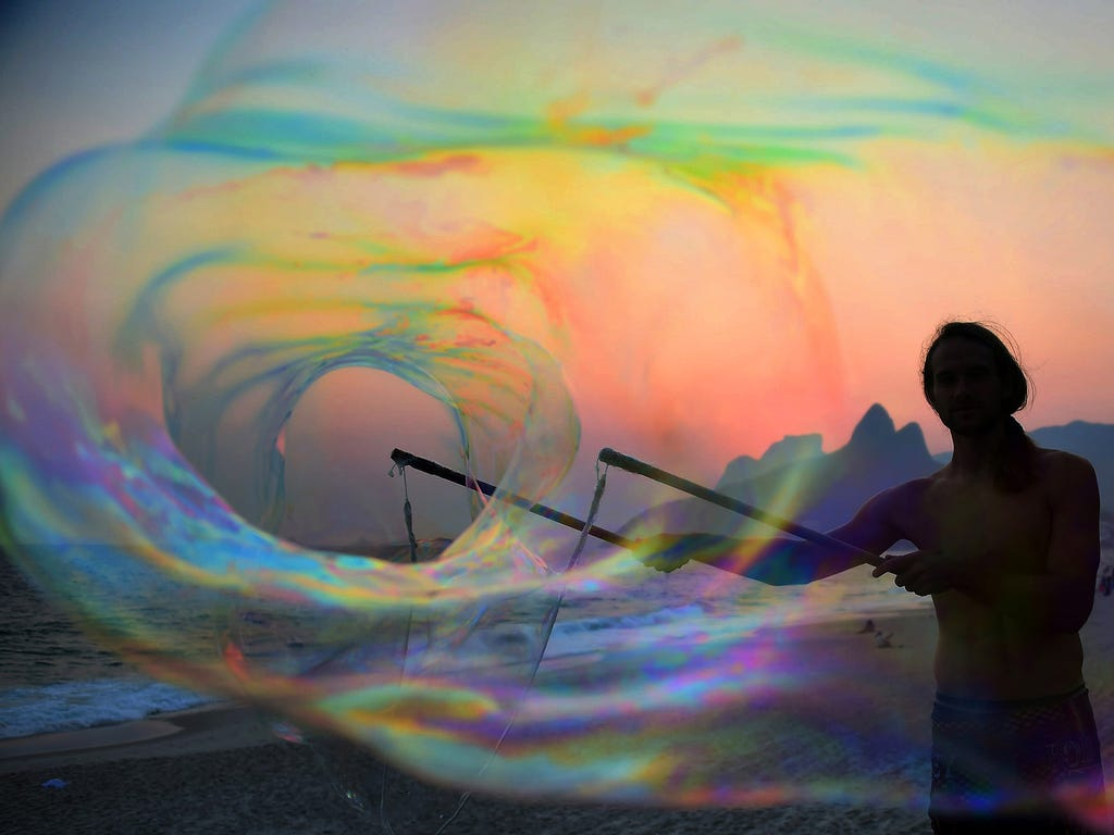 A German tourist creates huge soap bubbles at sunset on Oct. 13 on Ipanema Beach in Rio de Janeiro, Brazil.