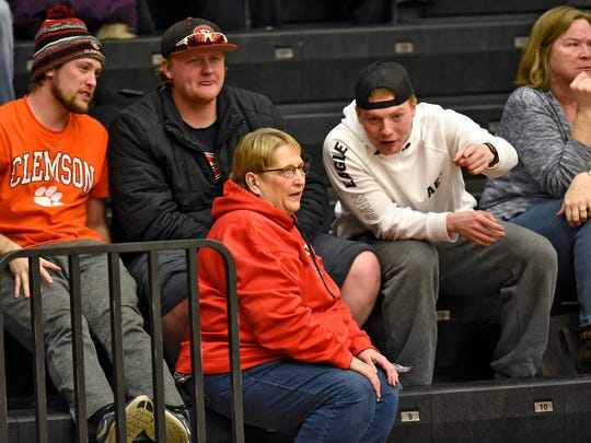 Dawn Schenk  talks with fellow fans during a St. Cloud State University women's basketball game Wednesday, Feb. 21, at Halenbeck Hall in St. Cloud.