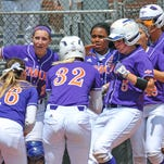 NSU's Cassandra Barefield is mobbed at home plate.