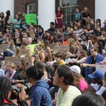 WILLIAM BRETZGER/THE NEWS JOURNAL Students protest sexual harassment and assault at the University of Delaware's Memorial Hall on Sept. 19, 2014. 300 students protest sexual harassment and assault at the University of Delaware's Memorial Hall, Friday, Sept. 19, 2014.