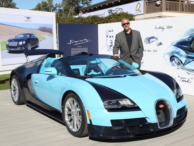 John HIll from Bugatti, stands next to their new Jean-Pierre Wimille edition Bugatti Veyron at the Quail Motorsports Gathering in Carmel Valley, Calif.