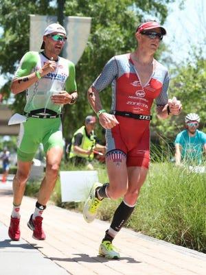 Matt Hanson, right, and Ivan Tutukin during the run at Ironman Texas last month.