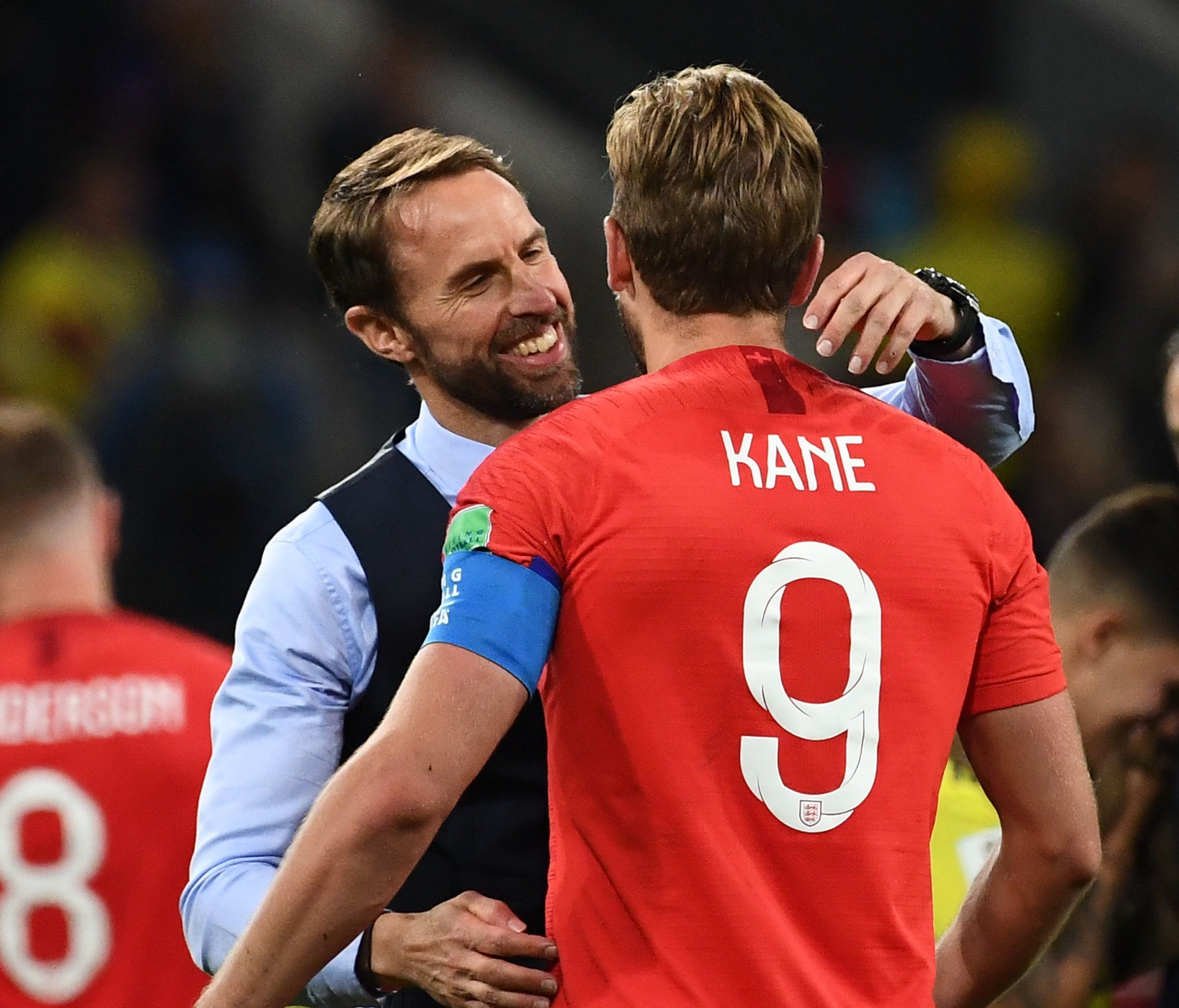 England's forward Harry Kane  is congratulated by Gareth Southgate.