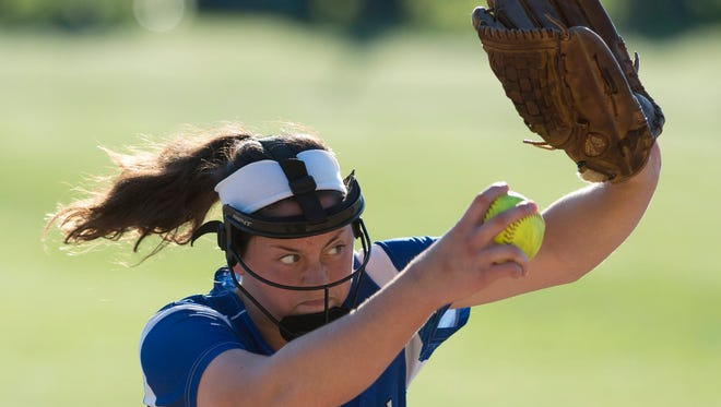 Memorial's Lily Beurman delivers a pitch to a Vincennes Lincoln batter during their 3A Regional #16 game at Nativity Field in Evansville Tuesday evening.