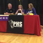 LSU signee Sara Funderburk, center, shares a laugh with her parents during a signing event at Parkway on Friday.