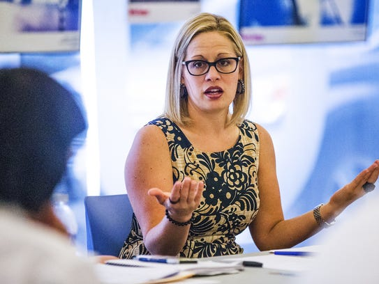 U.S. Rep. Kyrsten Sinema holds a roundtable discussion