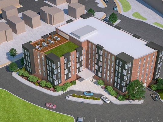 A rendering of a six-story condominium complex proposed along Evergreen Avenue in East Lansing.