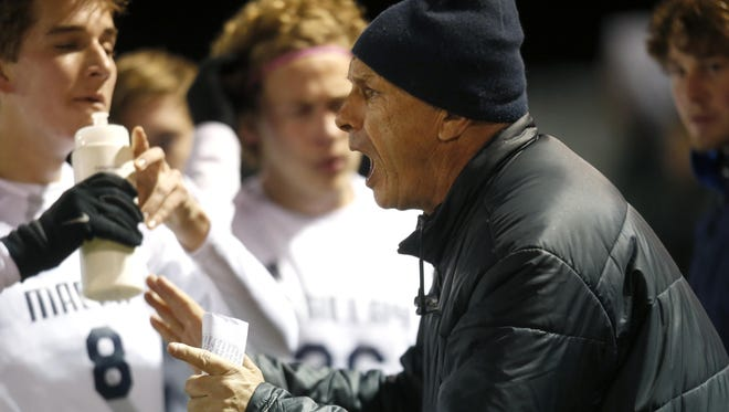 Maclay soccer coach Andy Warner talks to his team during a timeout in their District 1-1A final against West Gadsden at Maclay School last year.