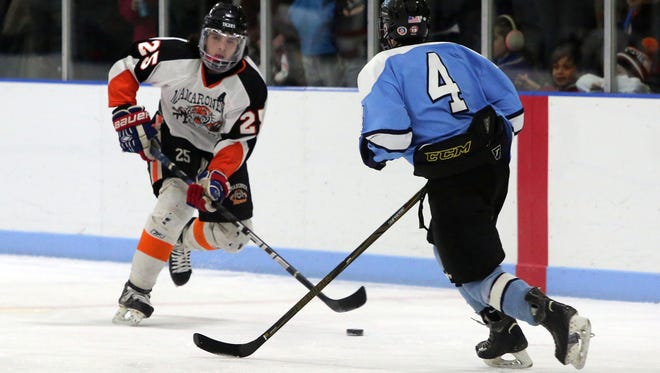 Mamaroneck's Mike Carducci moves the puck in front of Suffern's Hunter Churgin during their hockey game at the Hommocks Ice Rink in Larchmont, Jan. 6, 2017.