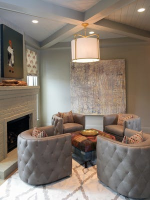 The Parade of Homes at Hideaway at Arrington includes a home built by Legend Homes, which features this sitting room with a fireplace.