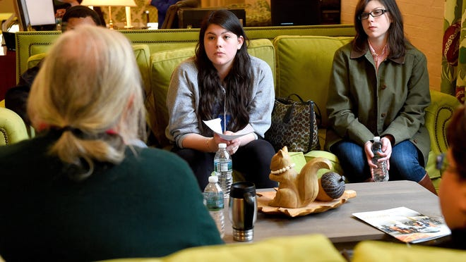 Sweet Briar College students Reiko Regan and Victoria Daniels speak with a Mary Baldwin College professor during their campus tour in Staunton in March, after it was announced at that time the all-women's college would close at the end of the 2015 academic year.