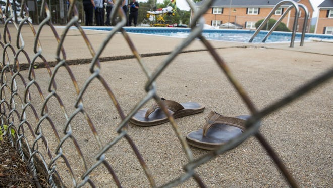 A pair of sandals sit on the deck of the pool where a man was found alone and unresponsive underwater at a Waynesboro apartment complex on Monday evening. Emergency responders worked to save his life for roughly half an hour, but ultimately were not successful.