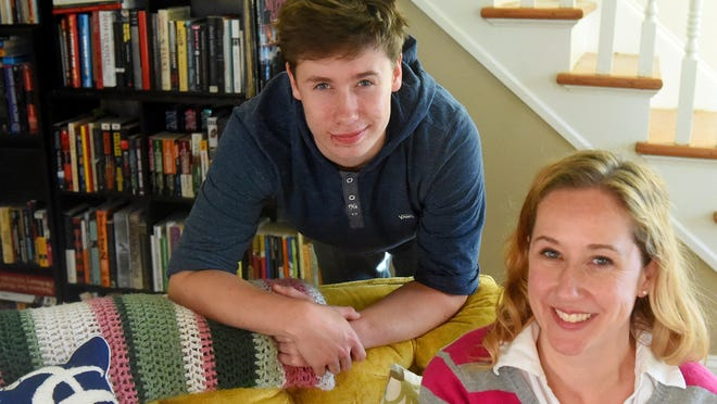 Aidan Harvey, 16, may be past the point of putting on a costume for Halloween, but that doesn't stop him from celebrating his birthday on the holiday each year. Aidan is photographed with his mother, Jacquie Patteson in their living room in Staunton on Thursday, Oct. 15, 2015.