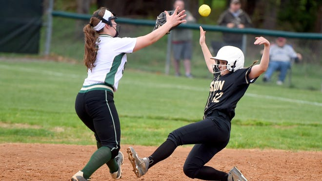 Buffalo Gap's Marybeth Strickler successfully steals second base as Wilson Memorial's Cheridan Hatfield catches the throw in the third inning during a softball game played in Fishersville on Friday, April 1, 2016.