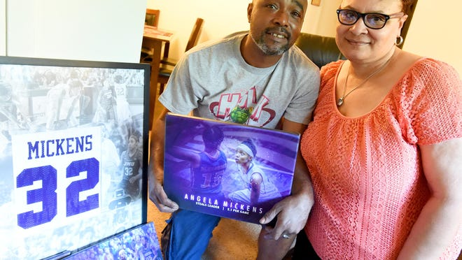 Leroy and Shea Mickens are the parents of James Madison University basketball's Angela Mickens, also a graduate of Robert E. Lee High School. The Mickens are photographed in their home on April 20, 2016.