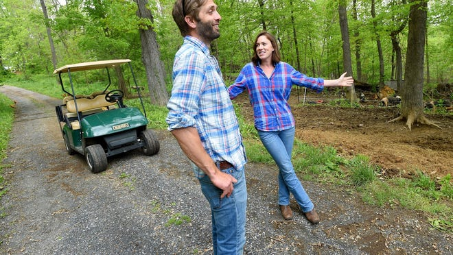 Owners of the farm, Andrew Crummett and his wife, Valerie McQueen Crummett, stand near where their free-range pigs are kept as they talk about how much they enjoy their life at Cool Breeze Farm near Mount Sidney on Tuesday, May 4, 2016.