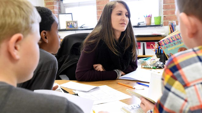 Taylor Flavin, an inclusive special education teacher, interacts with students Dec. 6 in a fourth-grade classroom where she co-teaches at Wenonah Elementary School.