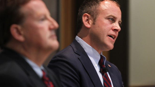 Candidates for the 54th District, Mark Elliott, left, and Gordon Hintz answered questions during a debate last month.